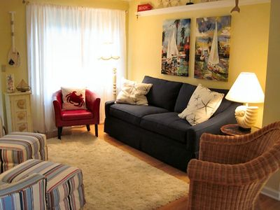 Spacious living area with all-new furniture, paint and decorator touches