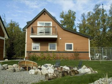 Wasilla cottage rental - 2nd Story Carriage House apartment overlooks firepit, view of Mountains