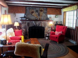 Saint-Sauveur cabin photo - Living room and the big stone fireplace.