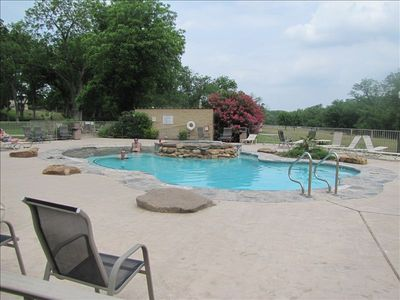Huge pool to cool off in and a large beautiful park like area to soak in the sun