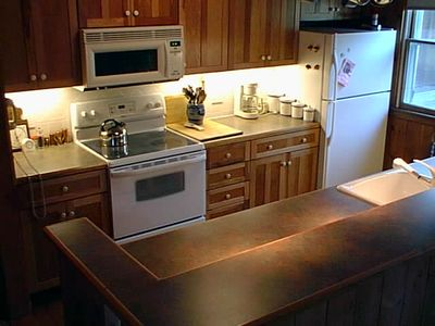 Full Kitchen with dishwasher, microwave & oven