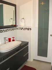 Isla Verde apartment photo - Bathroom basinet & a beautiful custom made door will take you to the shower area