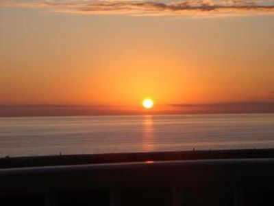 .fantastic sunsets from balcony, living room/dining area and kitchen