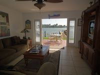 Magnificent Condo just 10 feet from water with private patio and grill