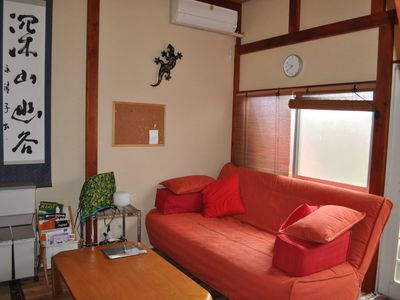 The bright living area has a double sleeper sofa, flat screen TV and iPod dock