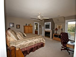 Windsor house photo - Tommy Bahama Suite with Queen Bed, gas fireplace and views of lake/pool