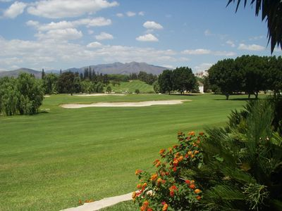 view over the golf course from the garden