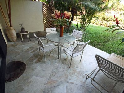 Rear lanai is perfect for eating out;144 sq. ft. tiled in for your enjoyment