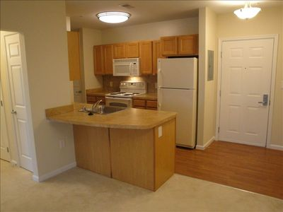 Full kitchen and breakfast bar with lots of counter and cabinet space