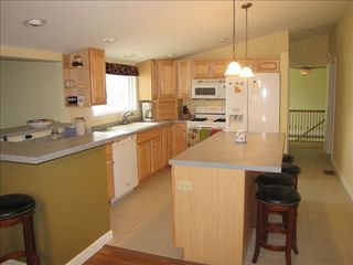 Cassopolis house photo - New Kitchen, vaulted ceilings offers additional bar seating open to living room
