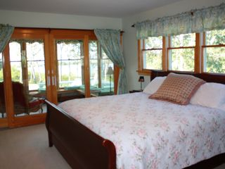 Oak Bluffs house photo - Master bedroom, waterview, and bonus sunroom beyond.