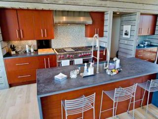 Chilmark house photo - Fully-Equipped Chef's Kitchen Features Fire Slate Countertops, Mahogany Cabinets, Breakfast Bar/Prep Island, Commerical Stainless Appliances, Plus Separate Prep Kitchen With Sink, Ovens & Cooking Gear