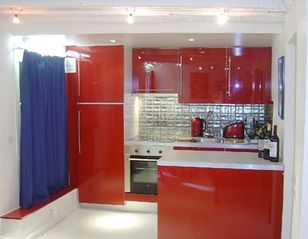 1st Arrondissement Louvre apartment photo - Open US Kitchen on one side of a large living room