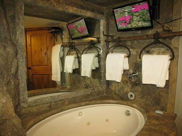 Wanna watch the game while sitting in a Jacuzzi Tub?