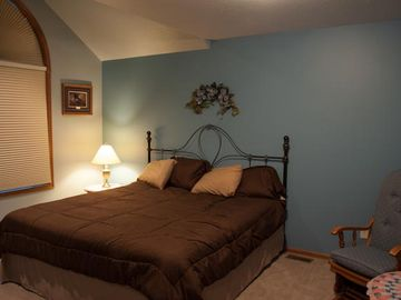 Upstairs room: king size bed, sitting area, walk-in closet and private bathroom