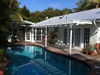 Tropical Retreat with private heated pool, deck and gardens
