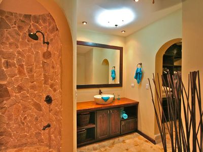 Guest suite bathroom with natural rock