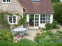 Cotswold stone cottage with picture-postcard garden in countryside