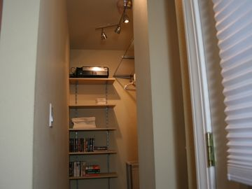 Accommodating closet holds full-length garments, plus a few books for free time.