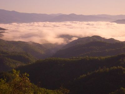 The clouds from the Smoky Mountains roll through the valley over Lake Fontana