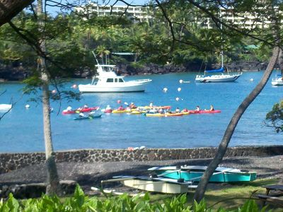 Walk to Keauhou Bay, rent kayaks, explore sea caves.