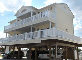 The front of house with decks all around