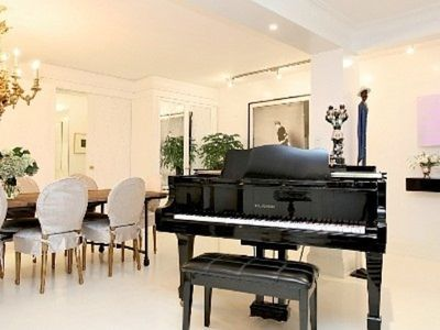 grand piano leads to open dining room (seats 10) and kitchen
