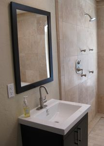 Master Bathroom: Travertine Shower with body sprays, Jacuzzi,wall-mounted sinks