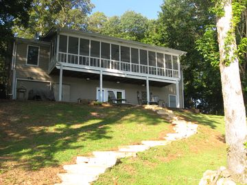 Lake Martin house rental - stone steps leading from lake to house