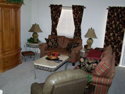 Living Area with Entertainment Center and recliner