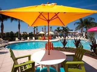 Kissimmee condo photo - Umbrella and tables for lunch/dinner