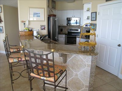 Kitchen area has beautiful granite counter tops, and stainless appliances