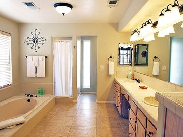Spacious Bathroom (1st) with Double Vanities, Shower and Soaking Tub.