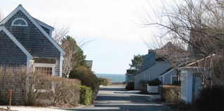 New Seabury cottage photo - View of ocean from side yard