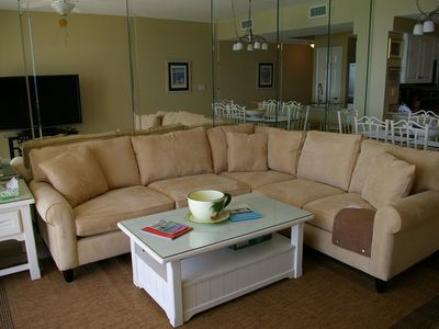Brand new sectional sleeper sofa offers plenty of comfortable seats.