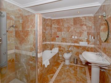 The Red Bathroom, like all the other bathrooms, is finished in luxurious marble.