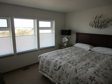 Master Bedroom. King bed, full bath, with closets and windows galore.
