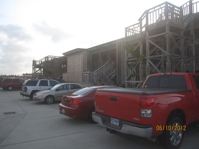 Port Aransas condo rental - Parking lot in rear of building has numbered parking spots for your convenience