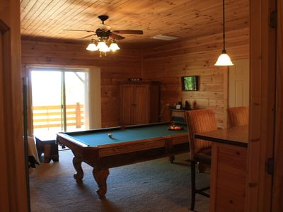 Game room with video games and a pool table