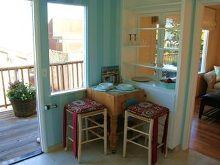 Pacific Grove house photo - Corner kitchen table for two with views of the bay over the back deck.