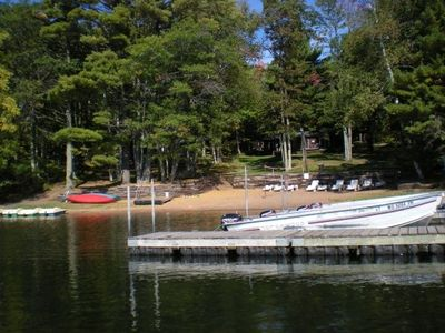 Iron River cabin rental - Sandy swimming beach with boats. Free use of boat, motor, paddleboats and canoes