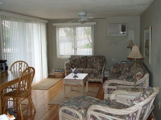 Beach Haven condo photo - Living area with sliding glass door to deck