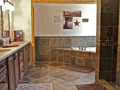 Master Bath with enclosed, slate stone shower and jacuzzi tub