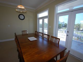 Fort Morgan property rental photo - The eight foot dinning table has seating for 10 or eat out on the balcony.