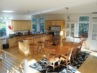 Wellfleet house photo - The clean, modern kitchen & dining area have high ceilings, A/C & bay views.