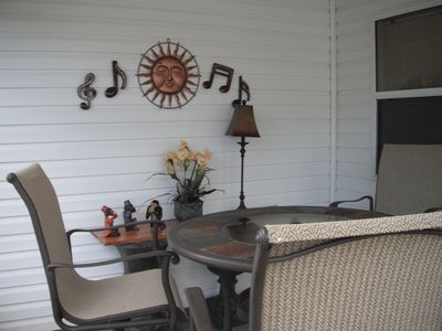 Outdoor lanai carpeted, ceiling fan, and fully furnished.