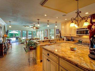 The kitchen has top-of-the-line appliances, marble counter tops.
