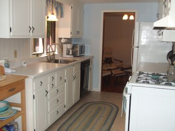 Kitchen with new refrigerator/stove