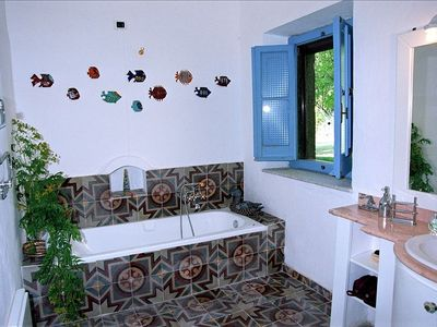 BATHROOM:BATHTUBE WITH SHOWER.XIX CENTURY TILES