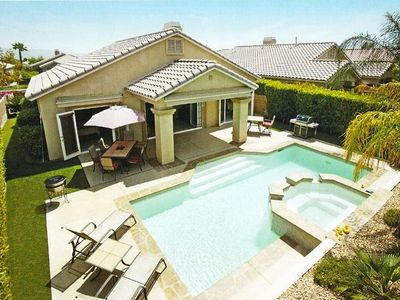 Beautiful backyard with pool, spa, covered patio, and gas barbeque